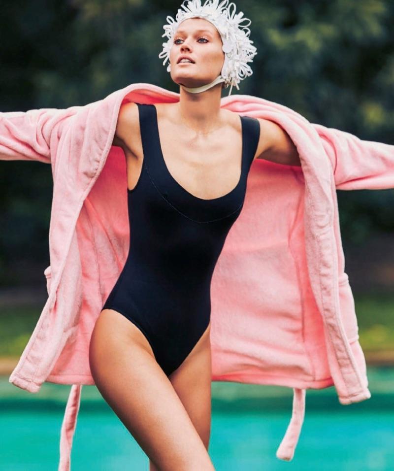 Toni Garrn models El Corte Ingles bathing suit with Miu Miu embellished cap and Zalando robe