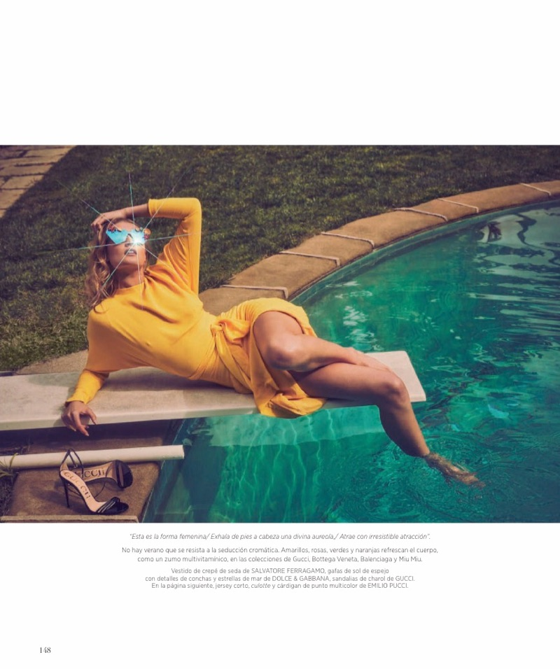 Lounging by the pool, Toni Garrn poses in Salvatore Ferragamo dress and Dolce & Gabbana sunglasses