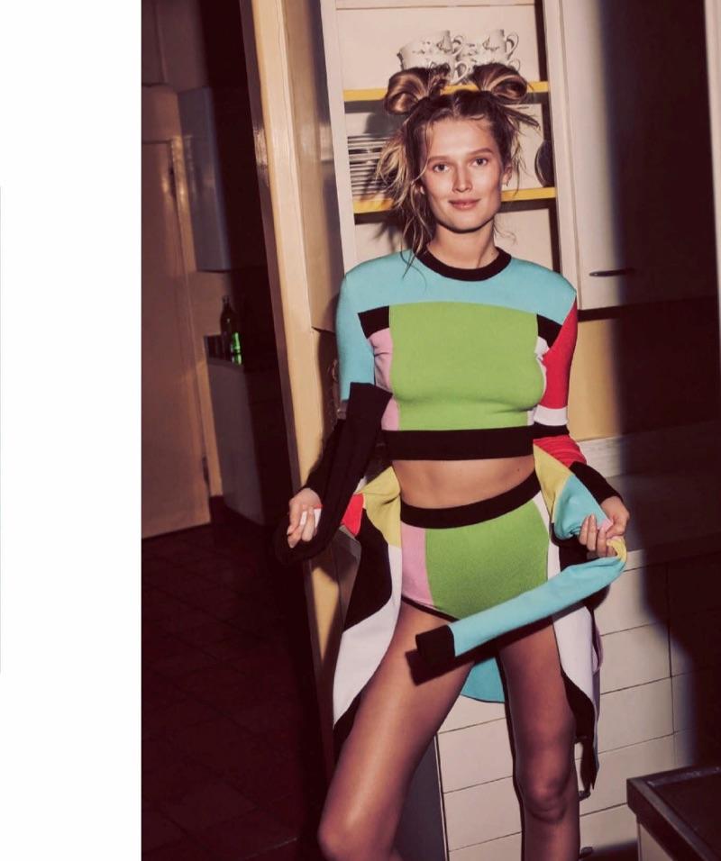 Embracing prints, Toni Garrn models Emilio Pucci jersey crop top, briefs and cardigan