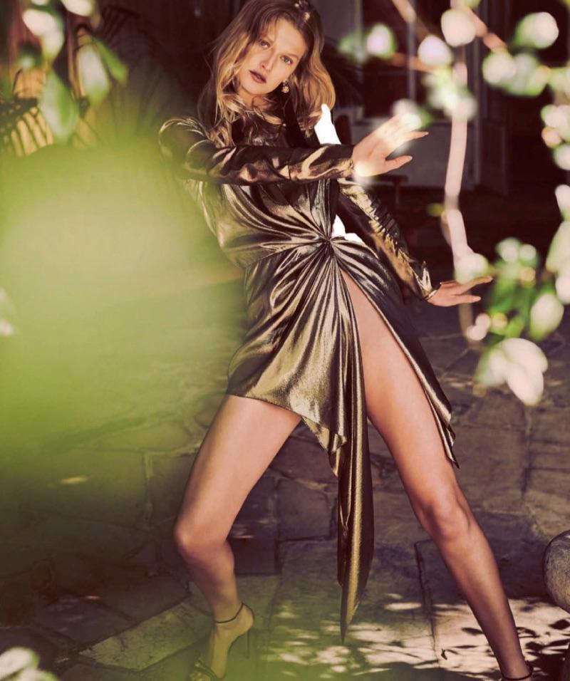Flaunting some leg, Toni Garrn wears gold Saint Laurent dress and Gucci sandals