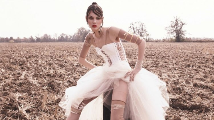 Vittoria Ceretti poses in corset top from Dolce & Gabbana and tulle skirt with Fenty by Puma boots