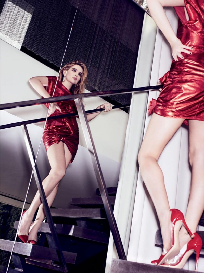 Looking red-hot, Zoey Deutch poses in scarlet minidress and heels