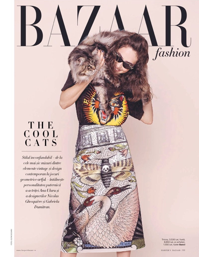 Posing with a cat, Ada Tache models a Gucci top and skirt
