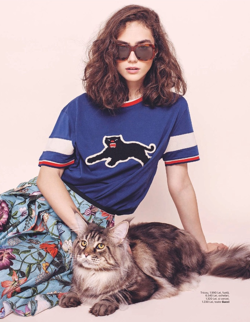 Posing with a cat, Ada Tache models Gucci t-shirt, skirt and sunglasses