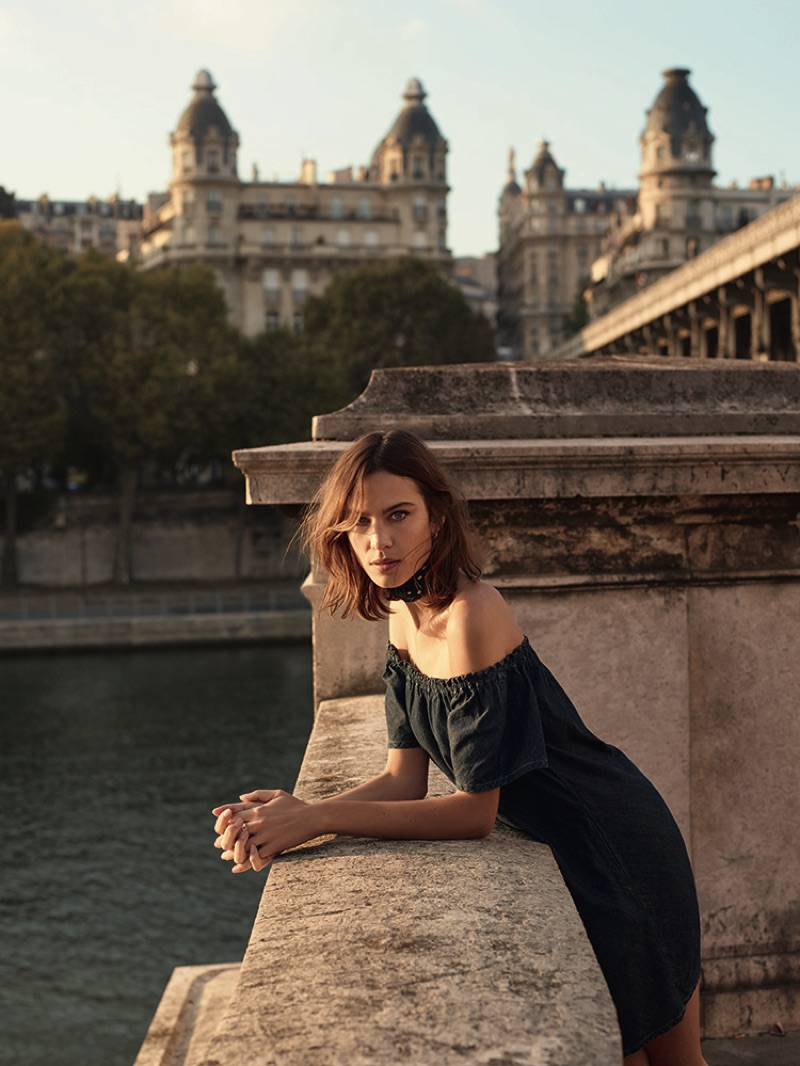 Alexa Chung poses in off-the-shoulder denim dress from AG