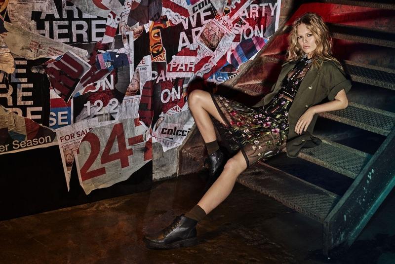 Anna Ewers kicks back in Colcci short-sleeve parka jacket and embellished sheer dress