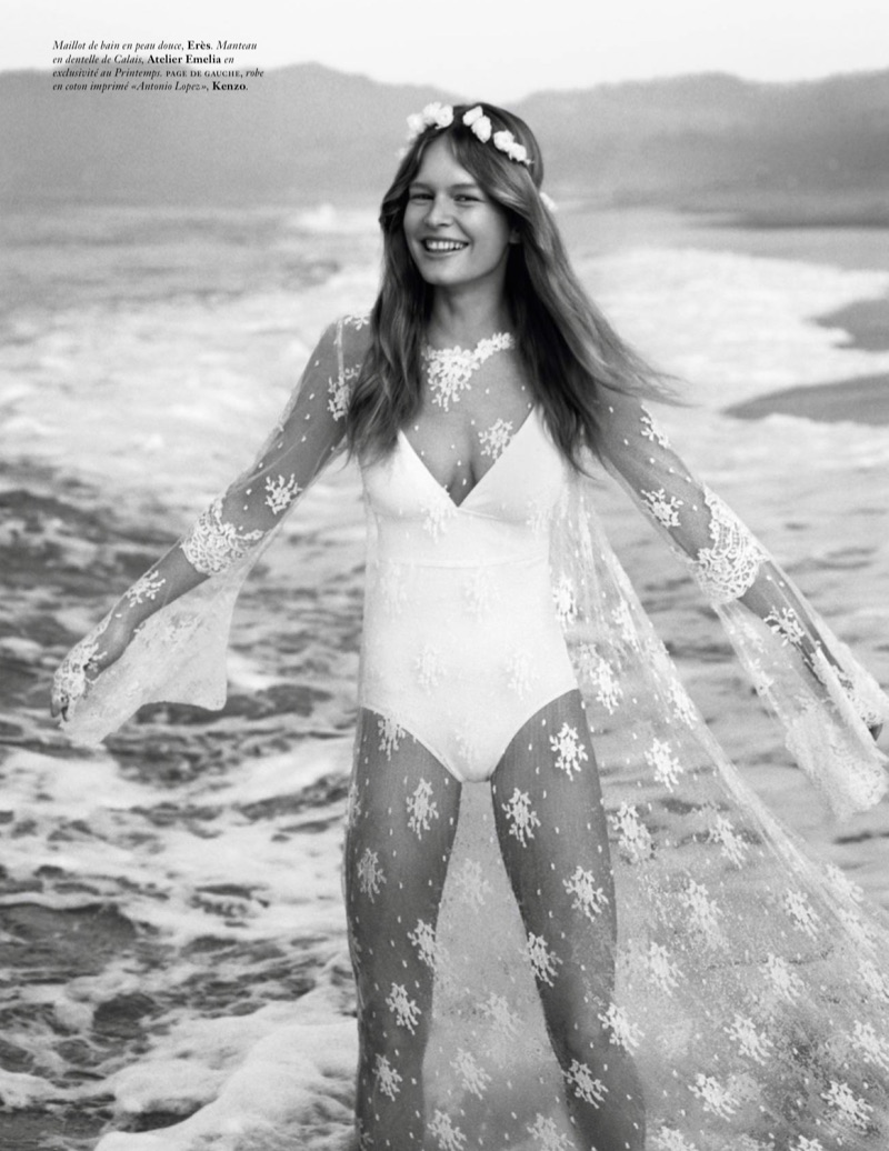 Posing at the beach, Anna Ewers models Eres swimsuit with Atelier Emelia lace coverup