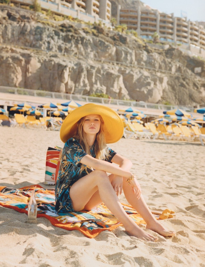 In the sand, Anna Ewers poses in Marni top, Albertus Swanepoel hat and Ancient Greek Sandals