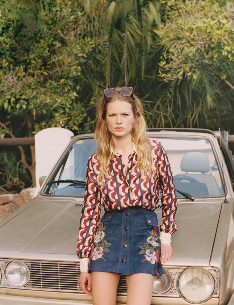 Anna Ewers models Gucci printed top, embroidered skirt and sunglasses