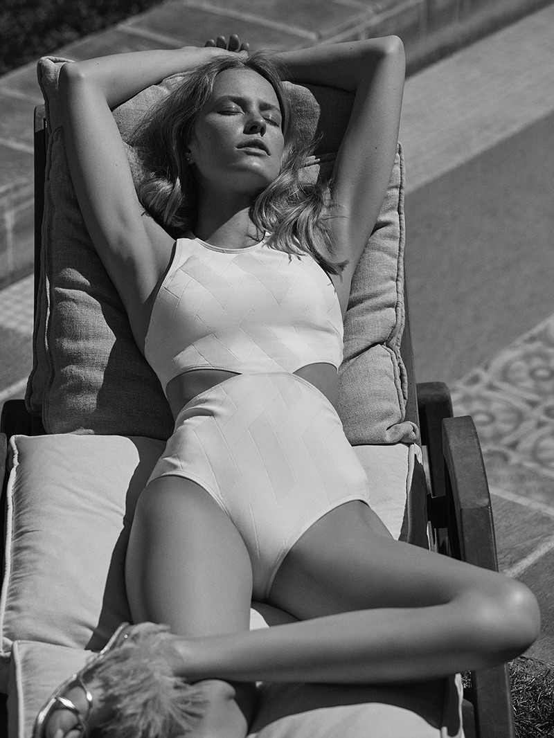 Photographed in black and white, Annelot de Waal wears swimsuit with side cut-outs