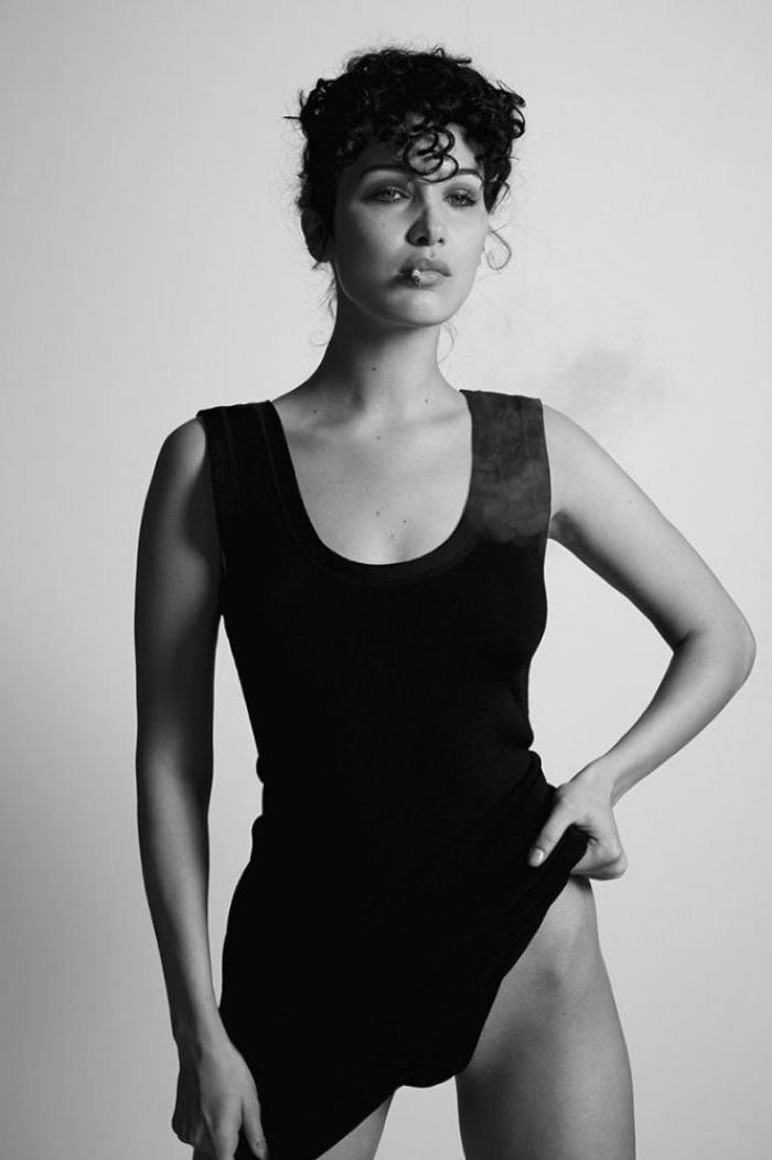 Posing with a cigarette, Bella Hadid wears a black bodysuit