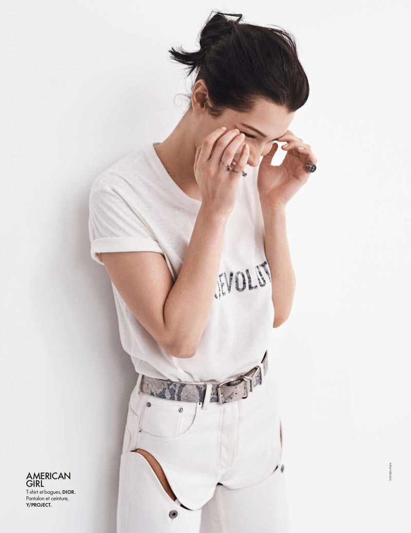 Dressed in white, Bella Hadid models Dior t-shirt with Y/Project pants and belt