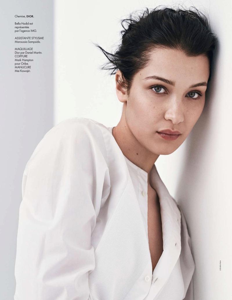 Model Bella Hadid poses in Dior shirt