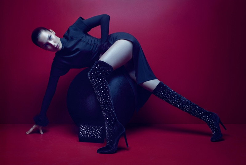 Model Bella Hadid wears embellished over-the-knee boots in Giuseppe Zanotti's fall-winter 2017 campaign
