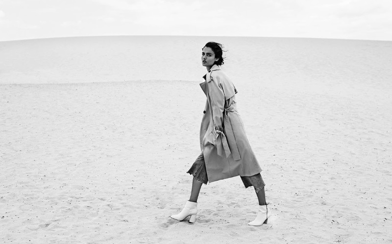 Blanca Padilla poses in Stradivarius trench coat and high-waist flared trousers