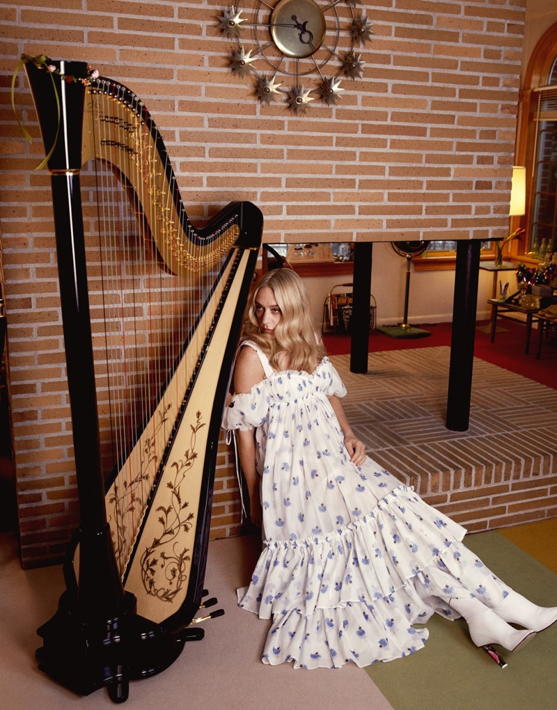 Posing next to a harp, Chloe Sevigny models Alexander McQueen dress and Vetements boots