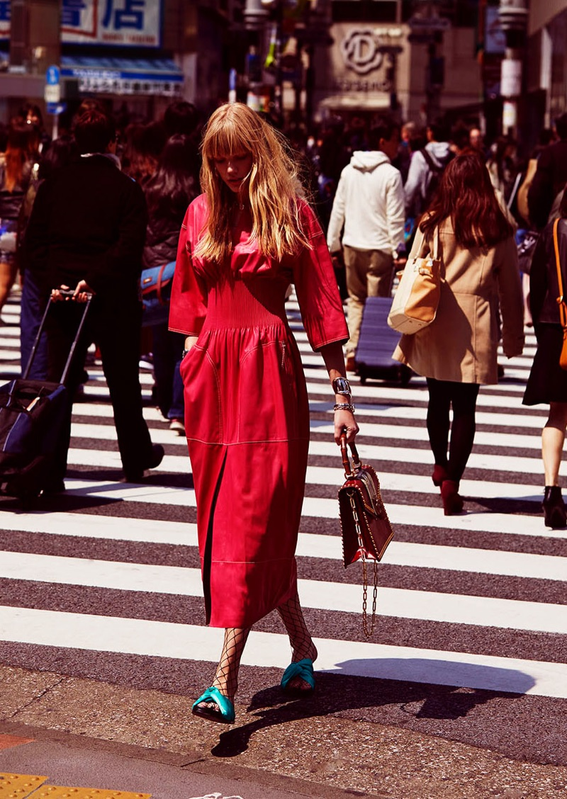 Posing on the streets of Tokyo, Clara Raddatz models Hermes dress, Maje sandals and Gucci bag