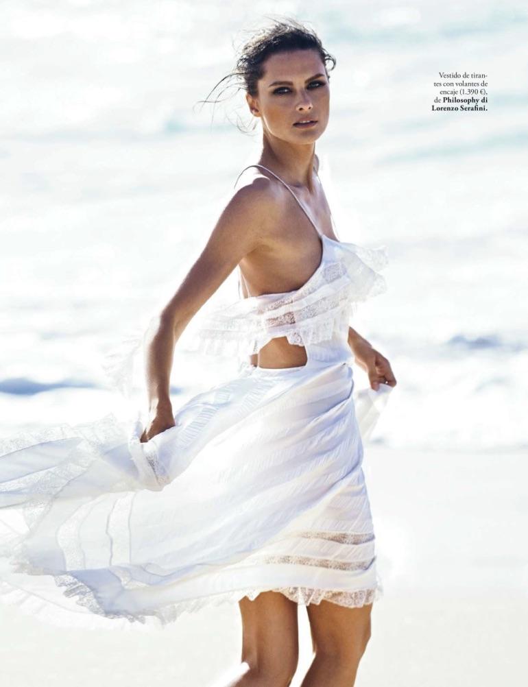Getting windswept, Elena Melnik models Philosophy di Lorenzo Serafini dress with ruffles and lace