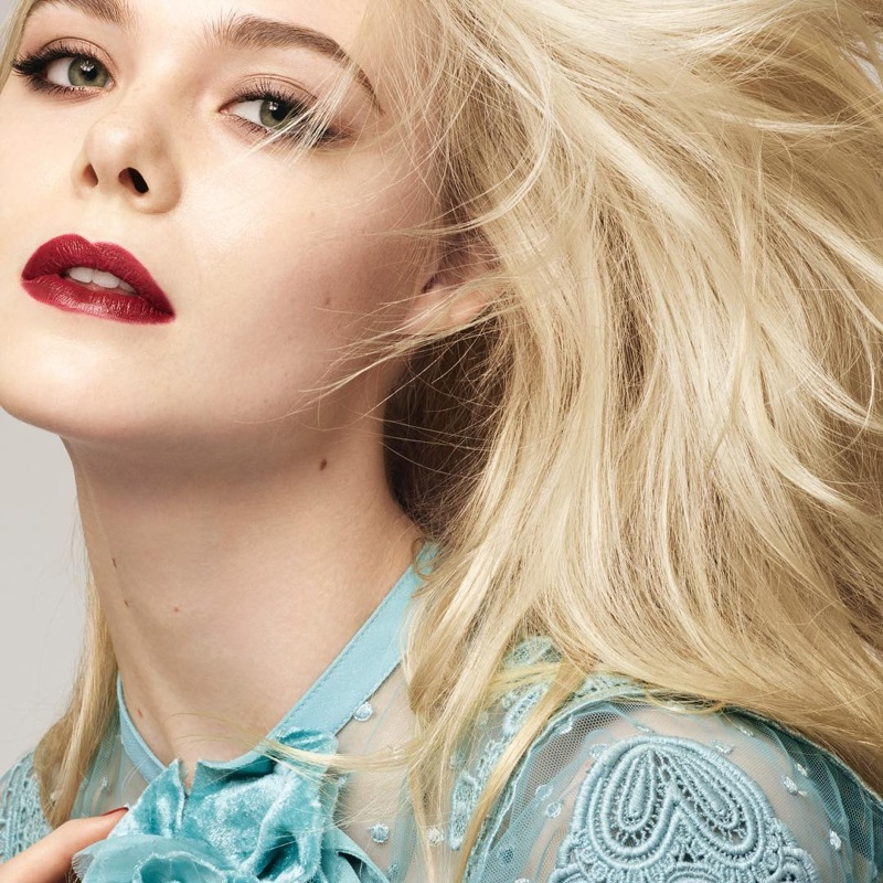 Actress Elle Fanning wears dark red color in visual for L'Oreal Paris