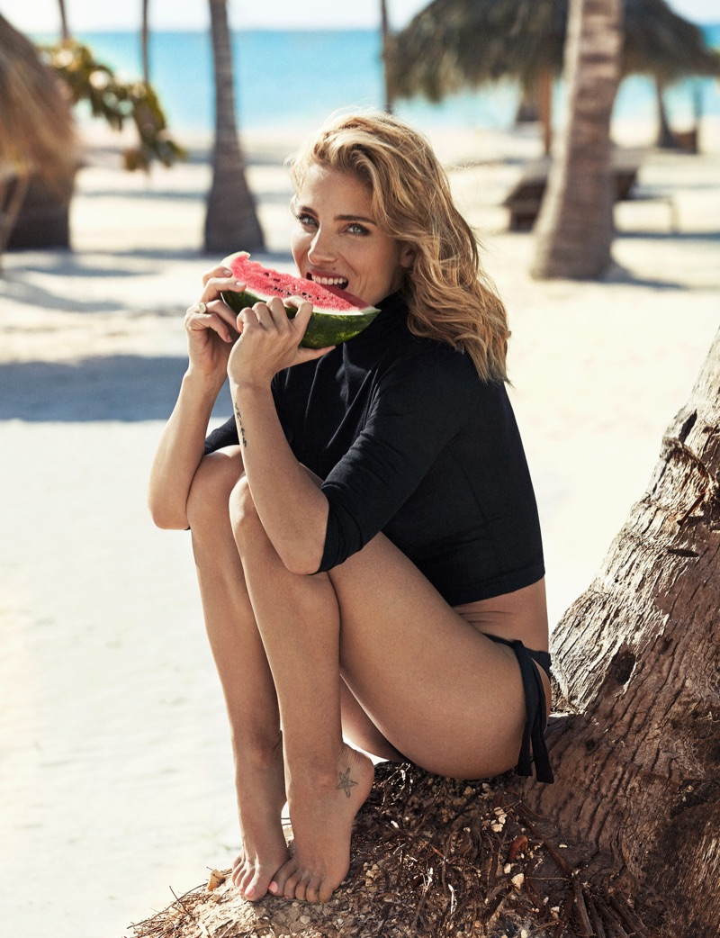 Taking a bite of watermelon, Elsa Pataky wears Prada sweater and Calzedonia bikini bottoms