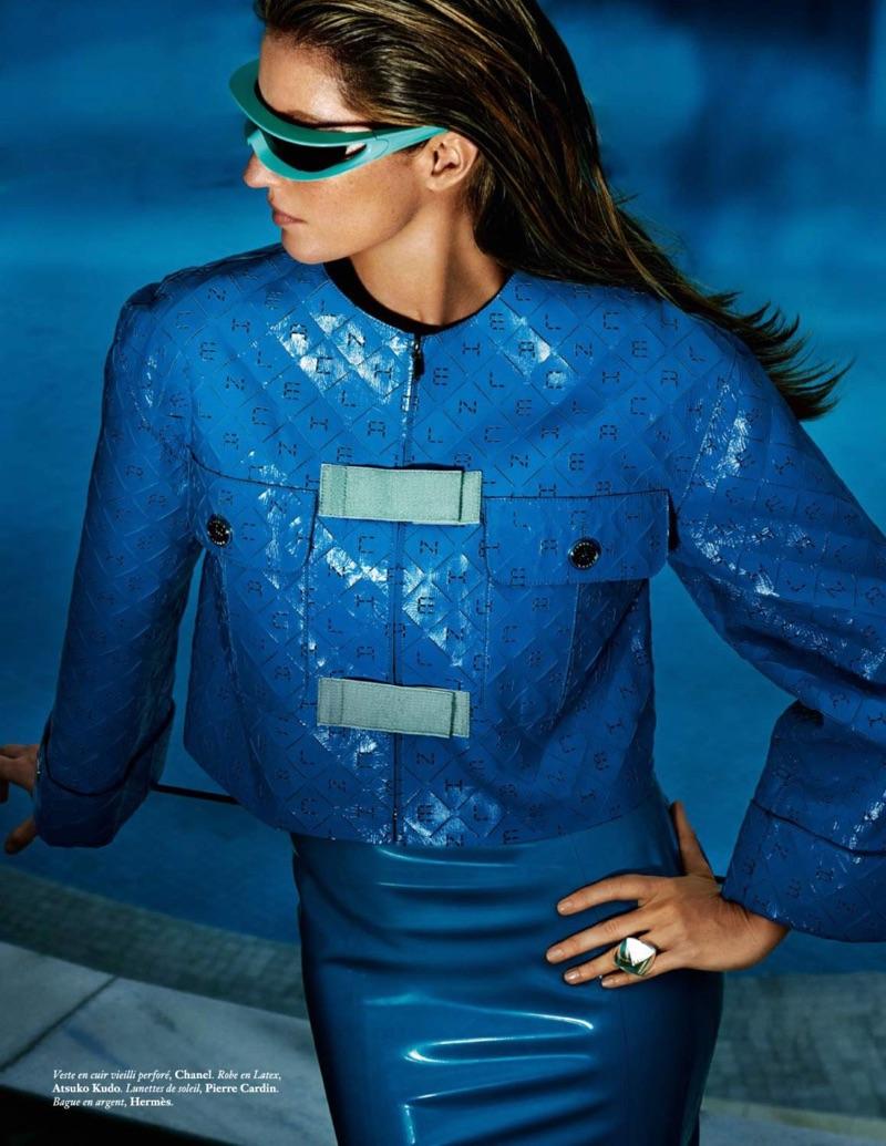 Dressed in blue, Gisele Bundchen models Chanel jacket with Atsuko Kudo latex robe and Pierre Cardin sunglasses