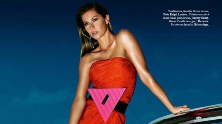 Looking red-hot, Gisele Bundchen models Polo Ralph Lauren strapless jumpsuit, Jeremy Scott belt and Balenciaga boots