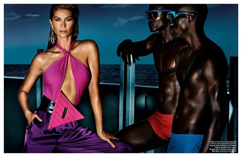 Striking a pose, Gisele Bundchen models Norma Kamali swimsuit, Jeremy Scott belt and Emporio Armani pants