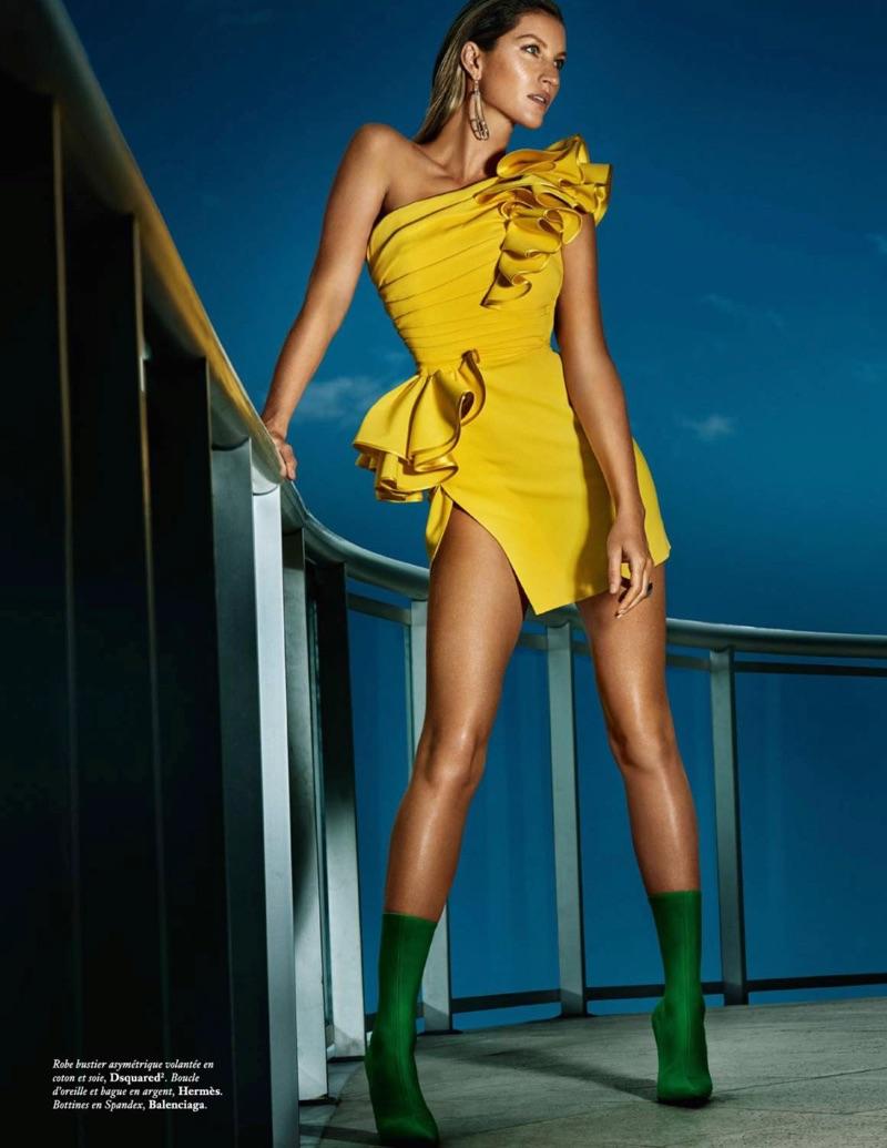 Gisele Bundchen models DSquared2 dress with ruffles and Balenciaga boots
