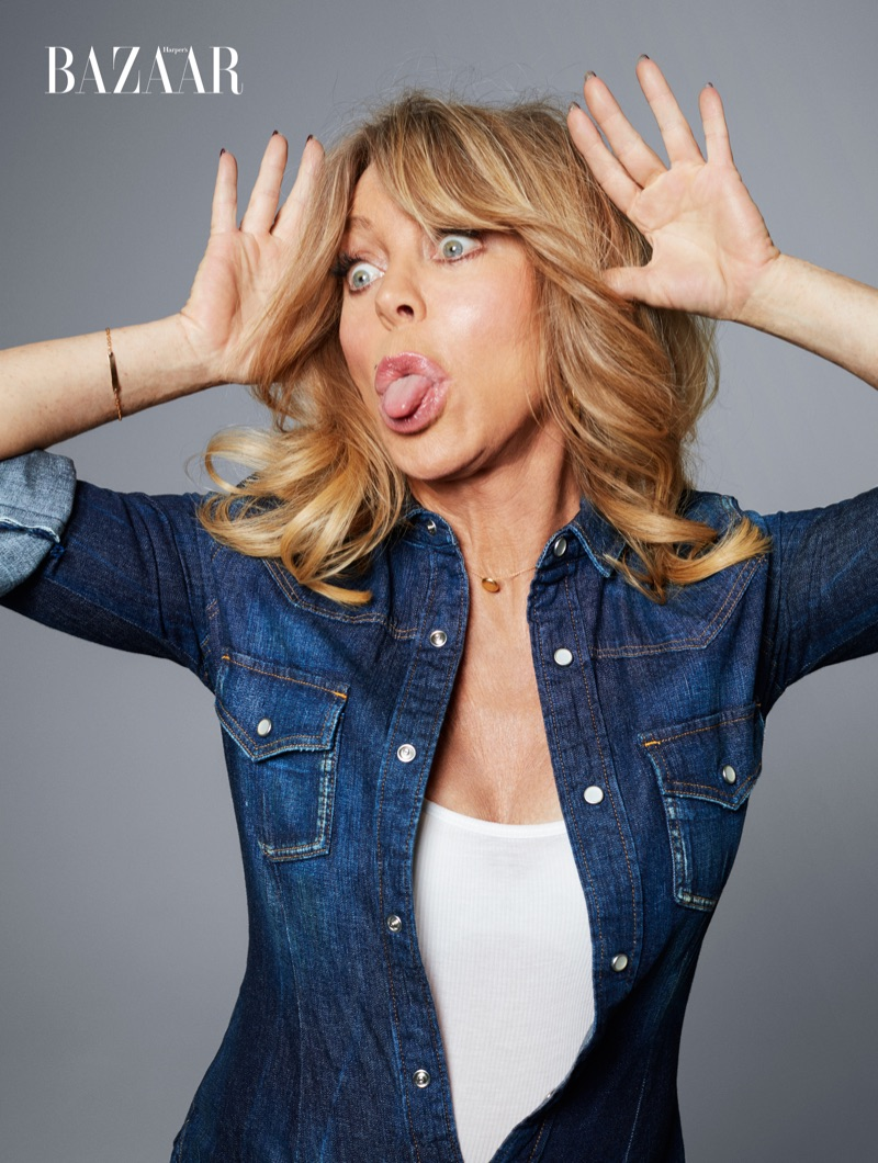 Sticking out her tongue, Goldie Hawn wears denim