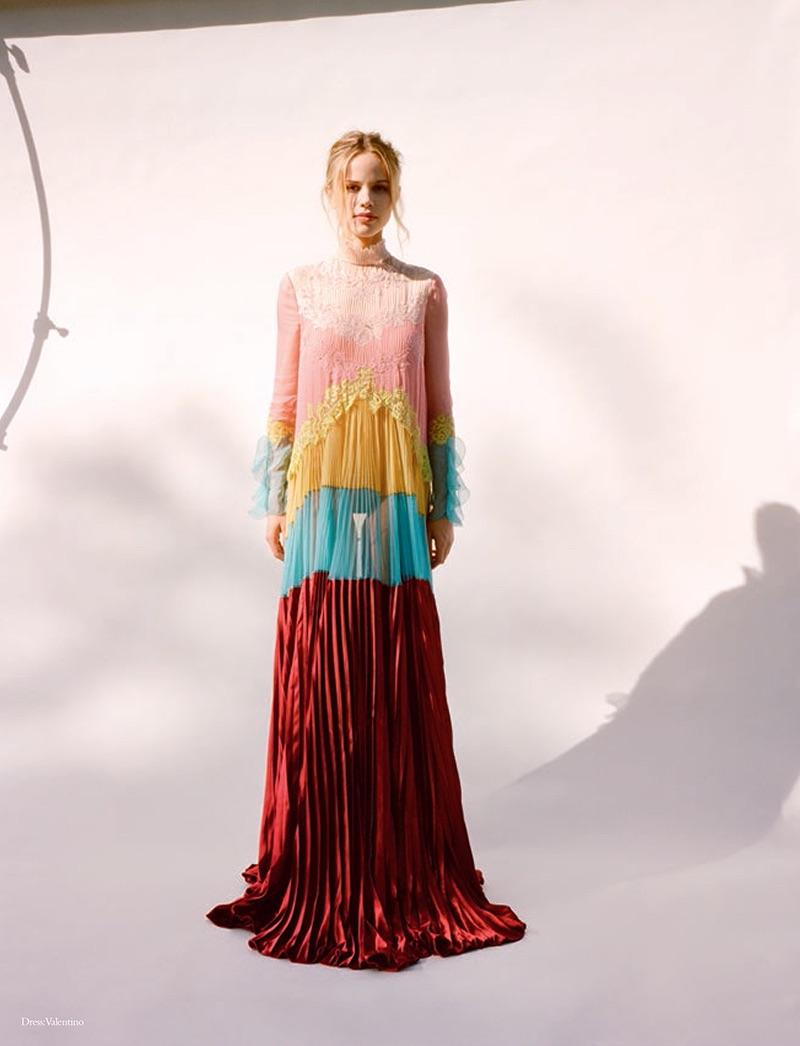 Actress Halston Sage poses in Valentino dress