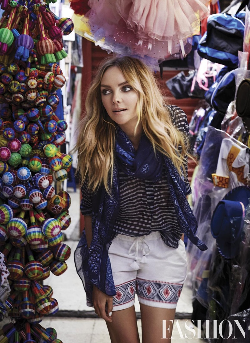 Going through a marketplace, Heather Marks looks casual chic in Joe Fresh outfit