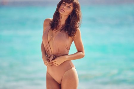 Supermodel Helena Christensen poses in an one-piece swimsuit from Debenhams