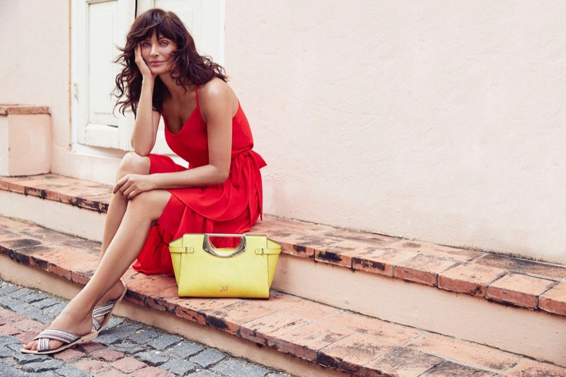 A lady in red, Helena Christensen models sleeveless dress in Debenhams' summer 2017 campaign