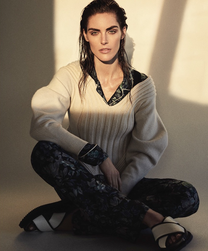 Model Hilary Rhoda wears Burberry sweater, shirt and pants with Boss sandals