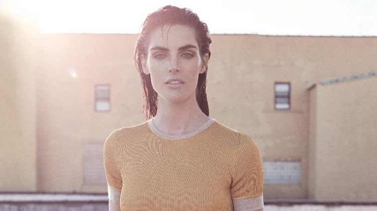 Taking on color-blocking, Hilary Rhoda poses in Dior, top, skirt and pants