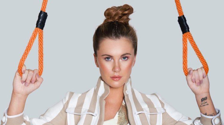 Standing strong, Irelend Baldwin models August Getty top, Fendi jacket and adidas skirt
