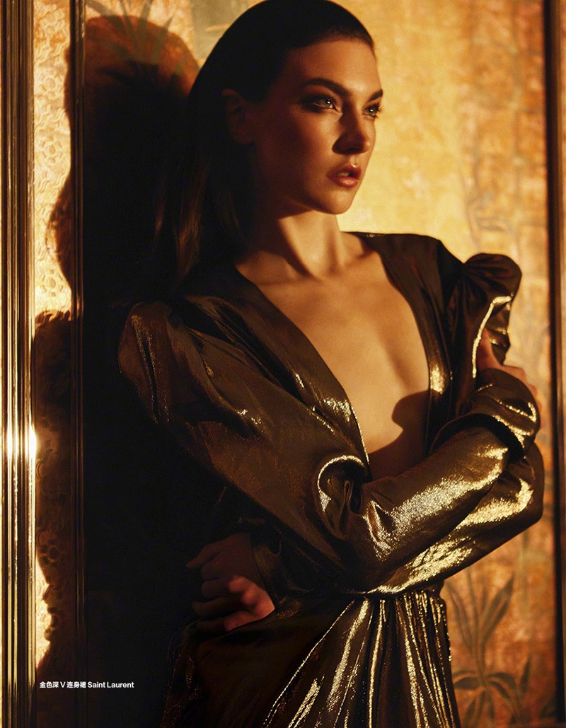 Shining in gold lamé, Jacquelyn Jablonski models Saint Laurent dress