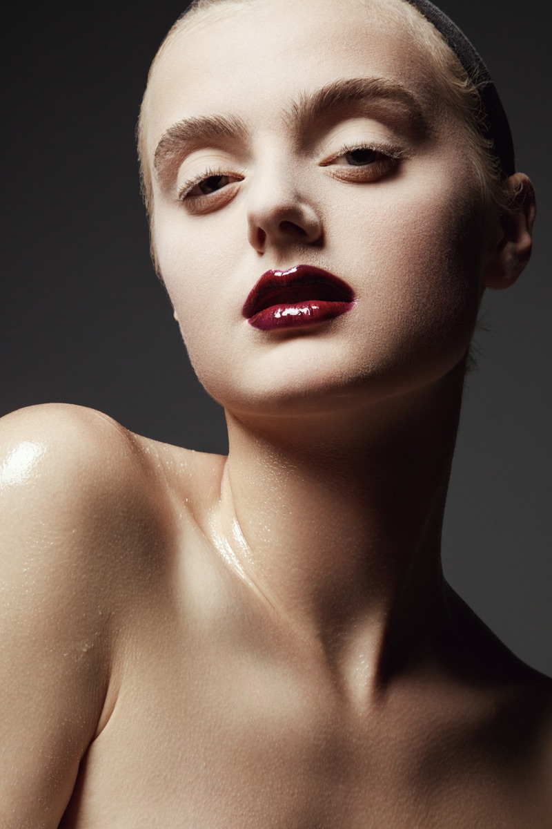 Carley Blayney tries on a dark lip color. Photo: Jeff Tse