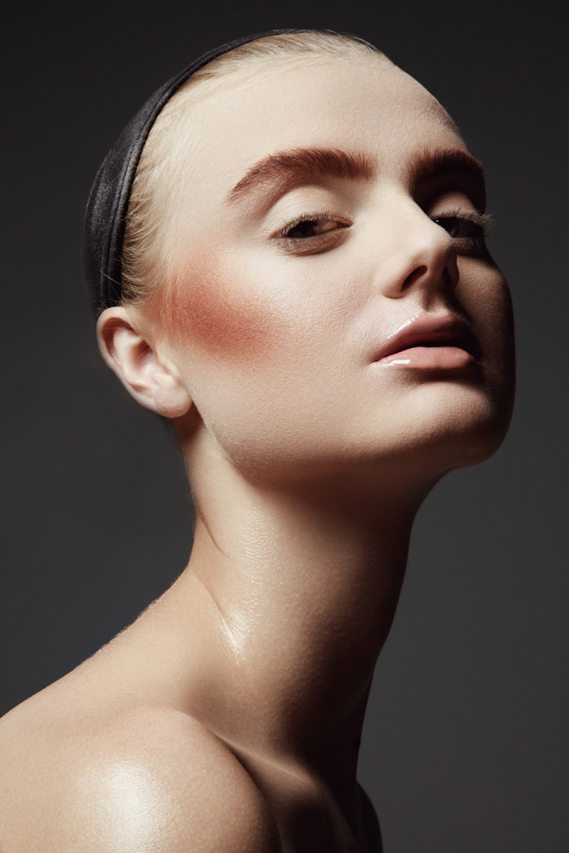 Carley Blayney shows off a bronzed cheek. Photo: Jeff Tse