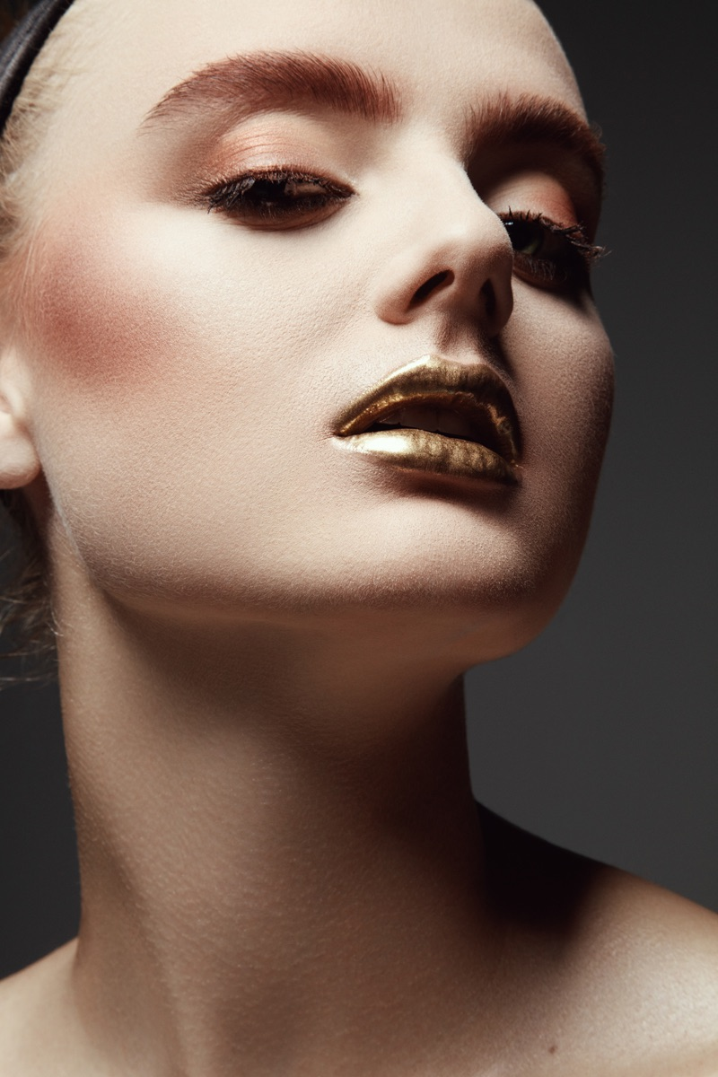 Carley Blayney tries on a metallic lip shade. Photo: Jeff Tse