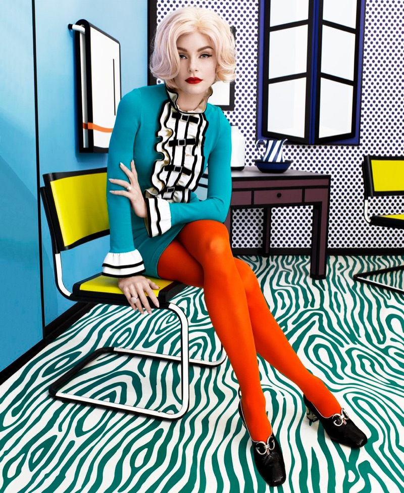 Posing at a Roy Lichtenstein exhibit, Jessica Stam wears Gucci dress, tights and shoes