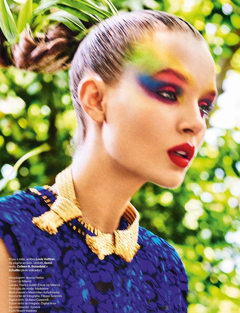 Getting her closeup, Josephine Skriver models rainbow-hued eyeshadow in Louis Vuitton blouse and necklace