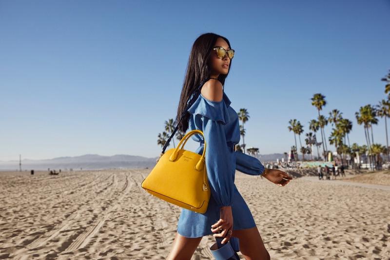 Jourdan Dunn models Mercer dome satchel bag from Michael Kors