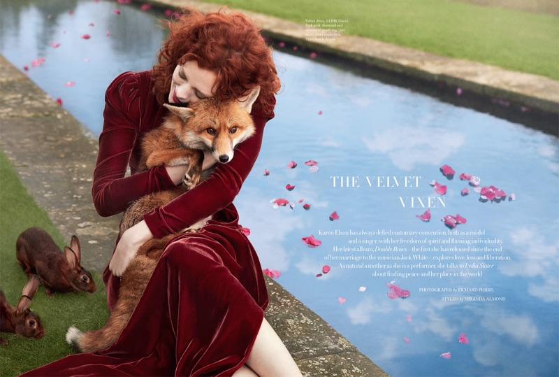 Holding on to a fox, Karen Elson poses in Gucci velvet dress