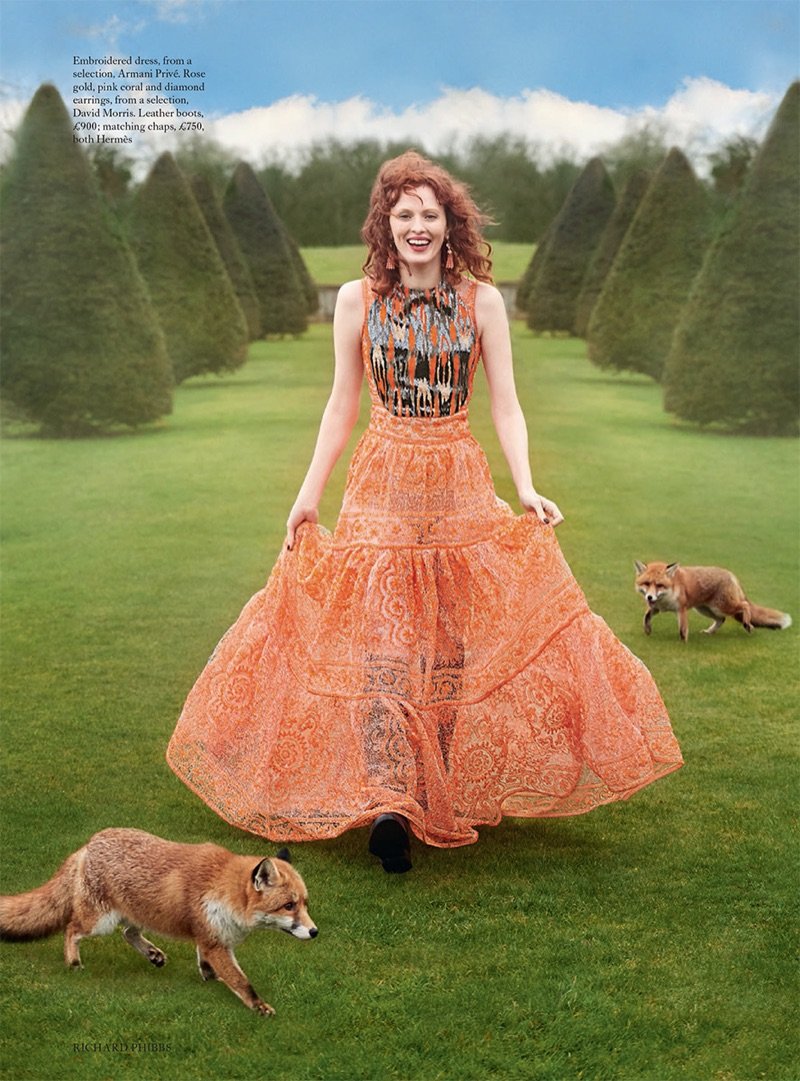 Strolling through greenery, Karen Elson wears Armani Prive embroidered gown and Hermes boots