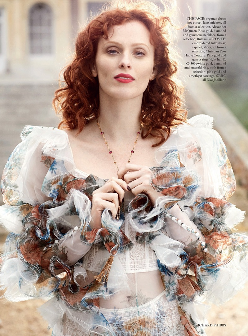 Karen Elson models Alexander McQueen ruffled organza dress and lace corset