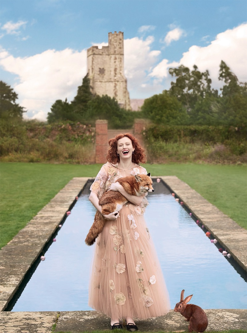 Model Karen Elson wears Dior Haute Couture embroidered tulle dress, cape and shoes