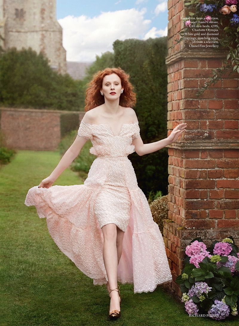 Looking pretty in pink, Karen Elson models Chanel Haute Couture lace dress and Charlotte Olympia calf-skin heels