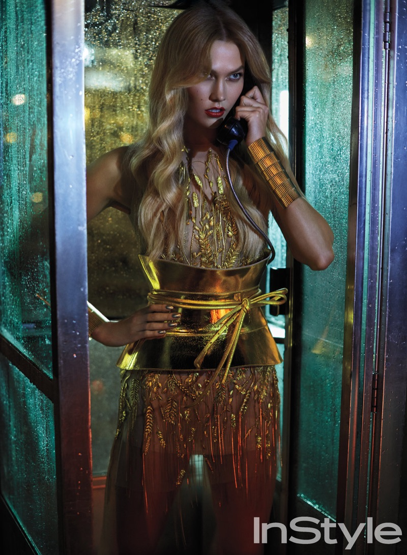 Shining in gold, Karlie Kloss poses in Gaultier Paris embroidered tulle dress and leather corset with Erickson Beamon cuffs