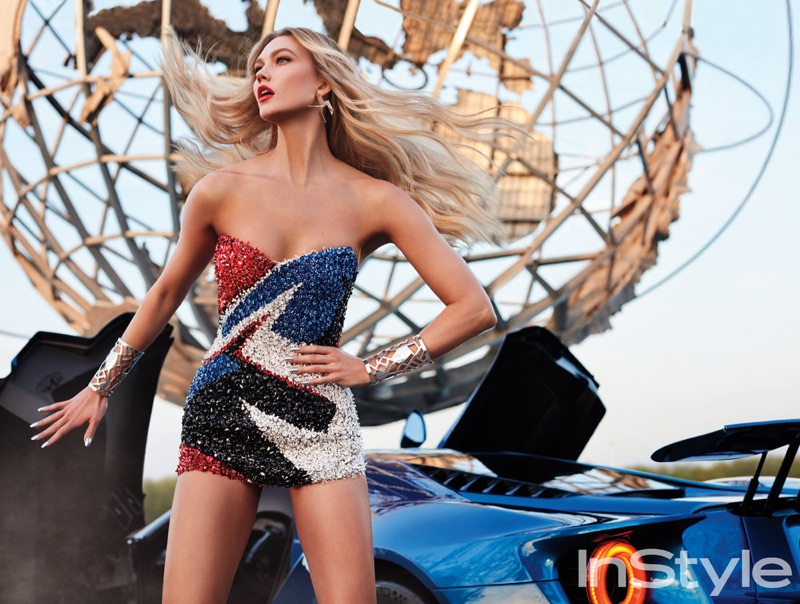 Karlie Kloss models Alexandre Vauthier strapless minidress with crystal embroidery and Marc Deloche earrings and cuffs